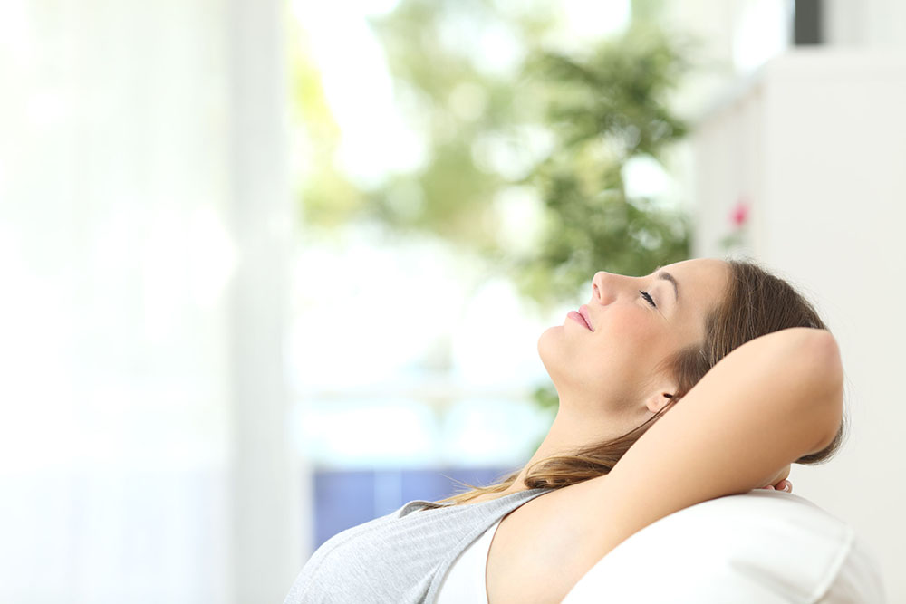 radiant barrier - woman relaxing